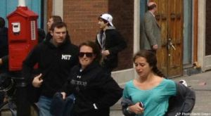 This Monday, April 15, 2013 photo shows a man who was dubbed Suspect No. 2 in the Boston Marathon bombings by law enforcement, on the left side of the frame, wearing a white baseball cap, walking away from the scene of the explosions. The FBI identified him as 19-year-old college student Dzhokhar Tsarnaev, who along with his brother Tamerlan, 26, previously known as Suspect No. 1, killed an MIT police officer, severely wounded another lawman and hurled explosives at police in a car chase and gun battle during a night of violence, early Friday, April 19, 2013. Tamerlan Tsarnaev was killed overnight, officials said, while his brother Dzhokhar remains at large. (AP Photo/David Green) EXCLUSIVE CONTENT-SPECIAL RATES APPLY FOR NON-AP MEMBERS AND SUBSCRIBERS.